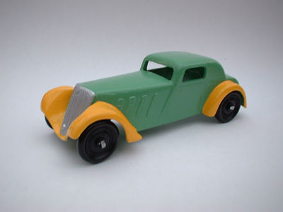 A DINKY TOYS COPY MODEL 22B FRENCH COUPE METAL WHEELS IN GREEN AND YELLOW