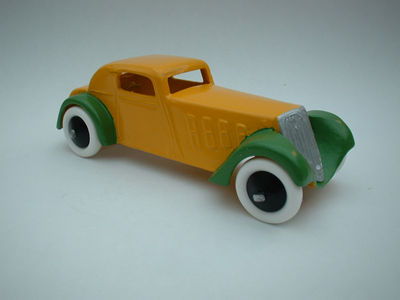 A DINKY TOYS COPY MODEL 22D FRENCH COUPE RUBBER TYRES IN GREEN AND YELLOW
