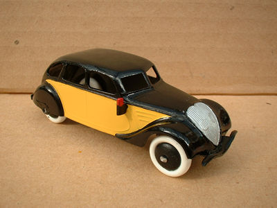 A DINKY TOYS COPY MODEL 24L PEUGEOT 402 TAXI YELLOW AND BLACK
